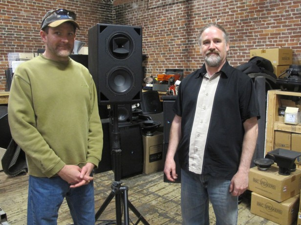 Fulcrum Acoustic engineer Rich Frembes (left) and founder Dave Gunness pose in their workshop. The company produces more than 2,000 speakers a year, often testing and tweaking the units obsessively to meet each client's specific needs. (Photo by Andrea Shea/WBUR.)